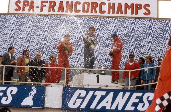 Spa-Francorchamps, Belgium.20-22 May 1983.Alain Prost (Equipe Renault) 1st position, Patrick Tambay (Ferrari) 2nd position and Eddie Cheever (Equipe Renault) 3rd position on the podium.Ref-83 BEL 03.World Copyright - LAT Photographic