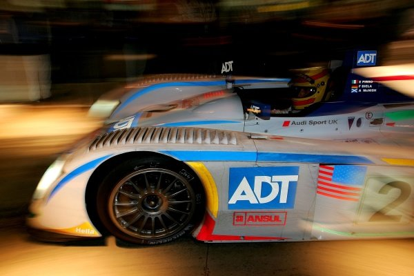Frank Biela (GER) / Emanuelle Pirro (ITA) / Alan McNish (GBR), Champion Racing Audi R8, leaves the pits during Wednesday nights practice session.