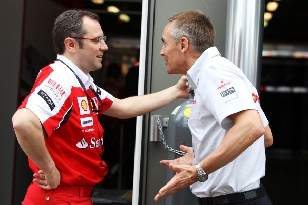 (L to R): Stefano Domenicali (ITA) Ferrari General Director talks with Martin Whitmarsh (GBR) McLaren Chief Executive Officer.