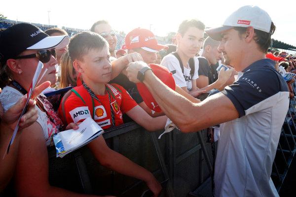 Hungaroring, Budapest, Hungary. Thursday 21 July 2016. Esteban Gutierrez, Haas F1 signs autographs for fans. World Copyright: Andrew Hone/LAT Photographic ref: Digital Image _ONZ0664