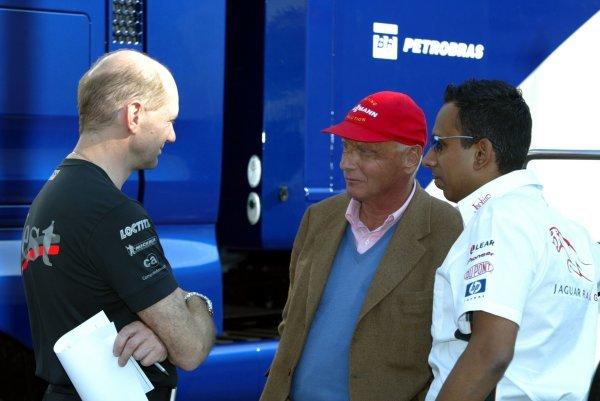 (L to R): Adrian Newey (GBR) McLaren Technical Director chats with Former Jaguar Team Boss Niki Lauda (AUT) and Nav Sidhu (GBR) Jaguar PR Manager.Formula One World Championship, Rd4, San Marino Grand Prix, Imola, Italy, 18 April 2003.DIGITAL IMAGE