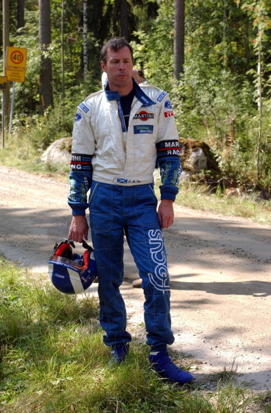 Colin McRae (GBR) Ford watches his car and 3rd place finish go up in smoke! FIA World Rally Championship, Rd9, Neste Rally Finland, Day Three, Finland. 11 August 2002. DIGITAL IMAGE