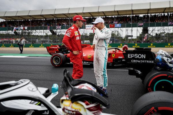 Charles Leclerc, Ferrari, talks with pole man Valtteri Bottas, Mercedes AMG F1, after Qualifying
