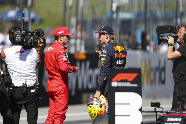 Pole man Charles Leclerc, Ferrari, talks with Max Verstappen, Red Bull Racing, after Qualifying