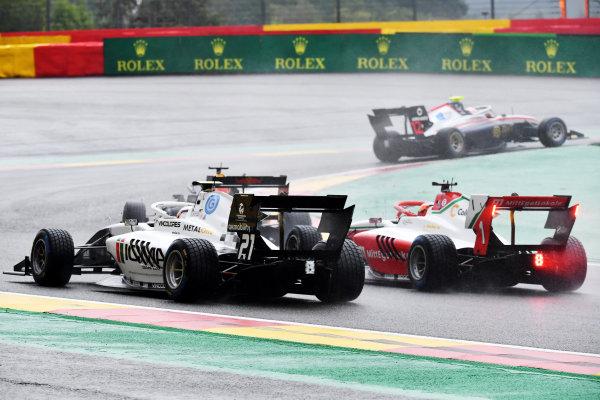 Roman Stanek (RUS, HITECH GRAND PRIX) leads a Red Bull car, Lorenzo Colombo (HUN, CAMPOS RACING) and Dennis Hauger (NOR, PREMA RACING)