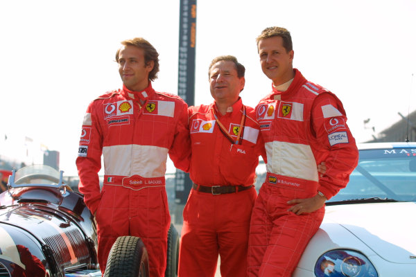 2002 American Grand Prix.Indianapolis, Indiana, USA. 27-29 September 2002.Testdriver Luca Badoer with Team Principal Jean Todt and Michael Schumacher (Ferrari).World Copyright - LAT Photographicref: Digital File Only