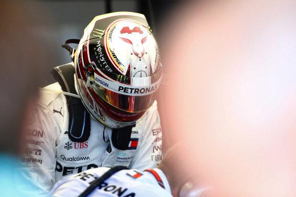Lewis Hamilton, Mercedes AMG F1 W09 EQ Power+, climbs into his car in the garage.