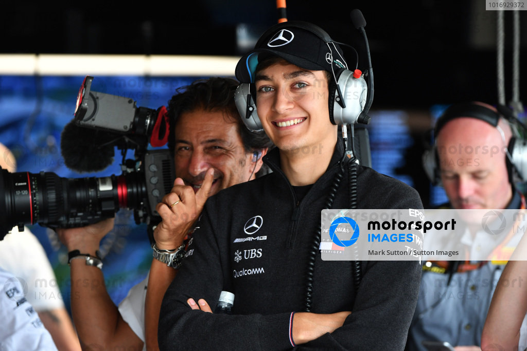 George Russell, Mercedes AMG F1 and Jean-Michel Tibi (FRA) FOM Cameraman