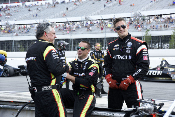 Penske crew members chat during the red flag following a multi-car accident on Lap 4.