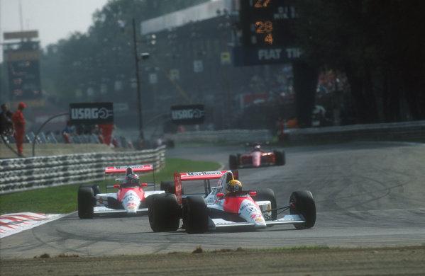 1990 Italian Grand Prix.Monza, Italy.7-9 September 1990.Ayrton Senna leads teammate Gerhard Berger (both McLaren MP4/5B Honda's) with Alain Prost (Ferrari 641) following behind.Ref-90 ITA 07.World Copyright - LAT Photographic