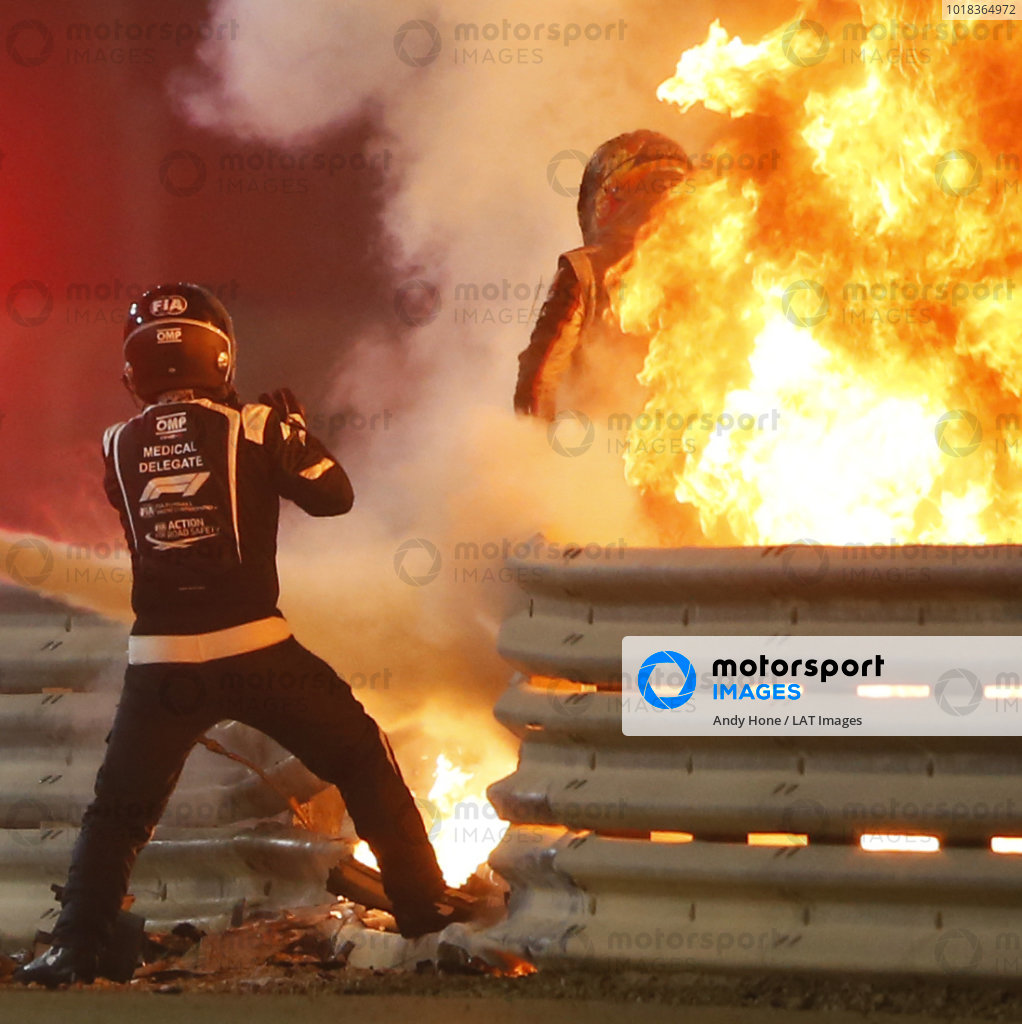 Romain Grosjean, Haas F1, emerges from flames after a horrific accident on the opening lap of the Bahrain Grand Prix. Marshals extinguish the fire