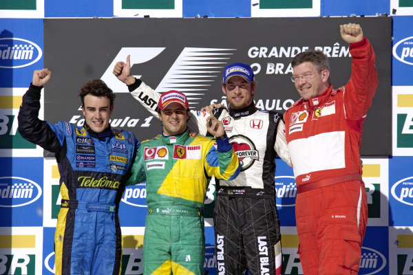 Podium group photo: Fernando Alonso, 2nd position, winner Felipe Massa, Jenson Button, 3rd position, and Ross Brawn.