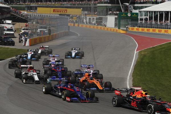 Max Verstappen, Red Bull Racing RB15, leads Daniil Kvyat, Toro Rosso STR14, Carlos Sainz Jr., McLaren MCL34, Antonio Giovinazzi, Alfa Romeo Racing C38, Alexander Albon, Toro Rosso STR14, and the remainder of the field at the start