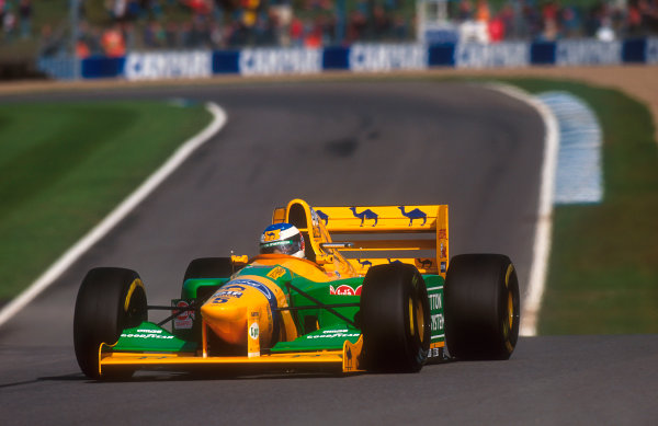 1993 European Grand Prix. Donington Park, England. 9-11 April 1993. Michael Schumacher (Benetton B193B Ford) at Coppice. He exited the race after he spun out. Ref-93 EUR 50. World Copyright - LAT Photographic
