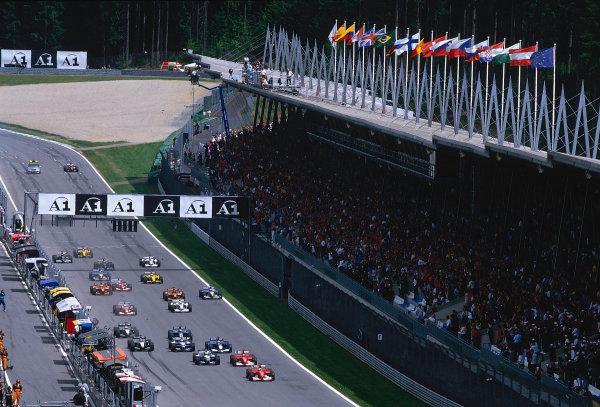 2002 Austrian Grand Prix.A1-Ring, Zeltweg, Austria.10-12 May 2002.Rubens Barrichello, Michael Schumacher (both Ferrari F2002's) and Ralf Schumacher (Williams FW24 BMW) lead the rest of the field away at the start.Ref-02 AUT 19.World Copyright - LAT Photographic