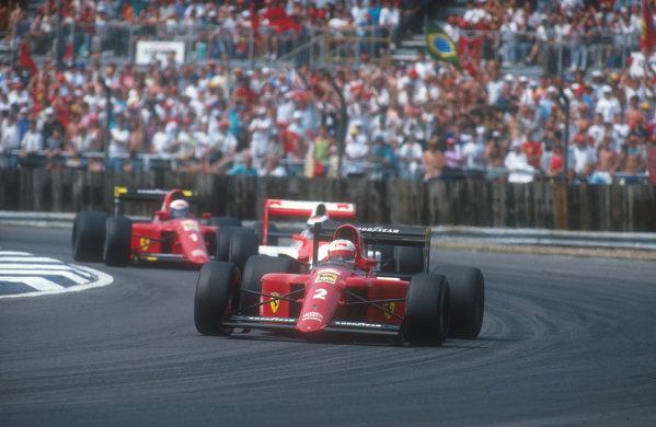 1990 British Grand Prix.Silverstone, England.13-15 July 1990.Nigel Mansell (Ferrari 641) leads Gerhard Berger (McLaren MP4/5B Honda) and Alain Prost (Ferrari 641) early on in the race.Ref-90 GB 27.World Copyright - LAT Photographic