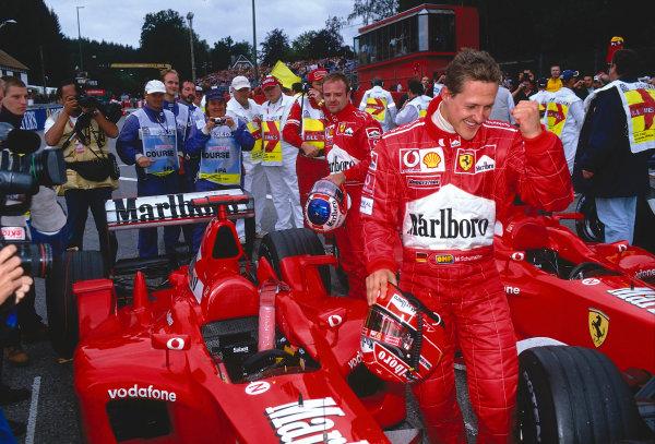 2002 Belgian Grand Prix.Spa-Francorchamps, Belgium. 30/8-1/9 2002.Michael Schumacher (Ferrari) celebrates his 1st position and record 10th Grand Prix win in a single season, in parc ferme. Rubens Barrichello (Ferrari) 2nd position stands behind. Ref-02 BEL 35.World Copyright - Tee/LAT Photographic