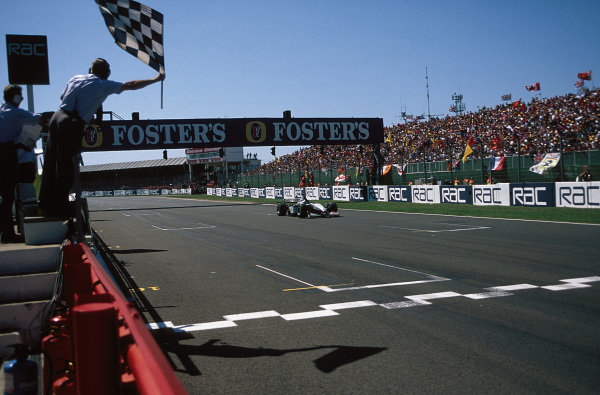 David Coulthard, McLaren MP4-14 Mercedes, celebrates victory as he takes the chequered flag.