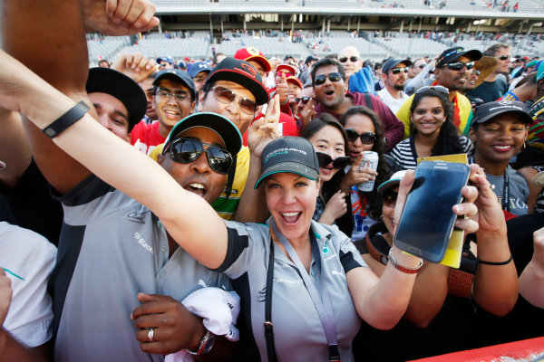 Circuit of the Americas, Austin, Texas, United States of America. Sunday 2 November 2014. Fans celebrate after the race. World Copyright: Charles Coates/LAT Photographic. ref: Digital Image _J5R1438