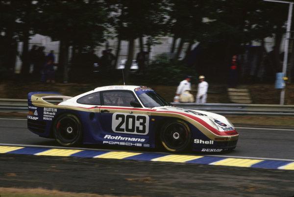 Le Mans, France. 10th - 11th June 1987. RenŽ Metge / Claude Haldi / Kees Nierop (Porsche 961), retired, action. World Copyright: Murenbeeld/LAT Photographic ref: 87LM11.