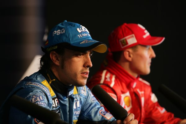 2006 British Grand Prix - Saturday Qualifying Silverstone, England. 8th - 11th June. Fernando Alonso, Renault R26 and Michael Schumacher, Ferrari 248F1 take questions in the FIA pole winners press conference, portrait. World Copyright: Charles Coates/LAT Photographic ref: Digital Image ZK5Y2288