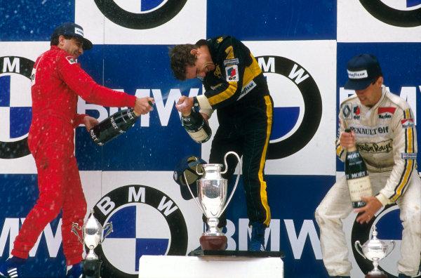 Estoril, Portugal.19-21 April 1985.Ayrton Senna (Team Lotus) 1st position, Michele Alboreto (Ferrari) 2nd position and Patrick Tambay (Equipe Renault) 3rd position on the podium.Ref-85 POR 10.World Copyright - LAT Photographic