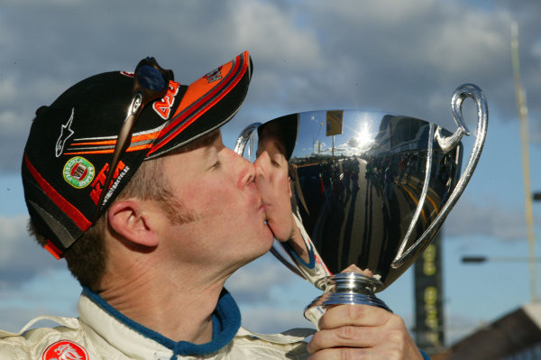2003 Australian V8 SupercarsBathurst 1000kms, Bathurst, Australia. 12th October 2003.Holden V8 Supercar driver Greg Murphy kisses his pole award after taking pole. Murphy dominated the weekend breaking the lap record in qualifying and the Shootout, Kelly is the youngest driver to win at Bathurst.World Copyright: Mark Horsburgh/ LAT Photographic