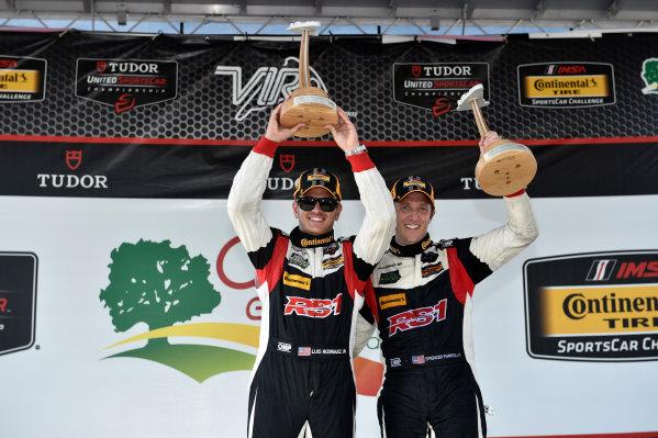 21-22 August 2015, Alton, Virginia USA 17, Porsche, Cayman, ST, Spencer Pumpelly, Luis Rodriguez Jr. celebrate the win on the podium ?2014, Scott R LePage  LAT Photo USA