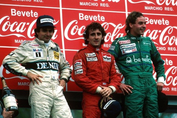 Winner Alain Prost (FRA), 2nd place Nelson Piquet (BRA) and 3rd place Gerhard Berger (AUS) celebrate on the podium