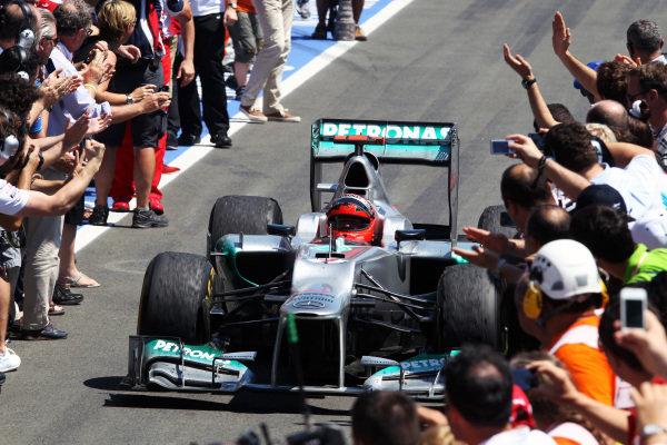 Michael Schumacher (GER) Mercedes AMG F1 W03 celebrates in parc ferme. Formula One World Championship, Rd8, European Grand Prix, Race Day, Valencia, Spain, Sunday 24 June 2012. BEST IMAGE