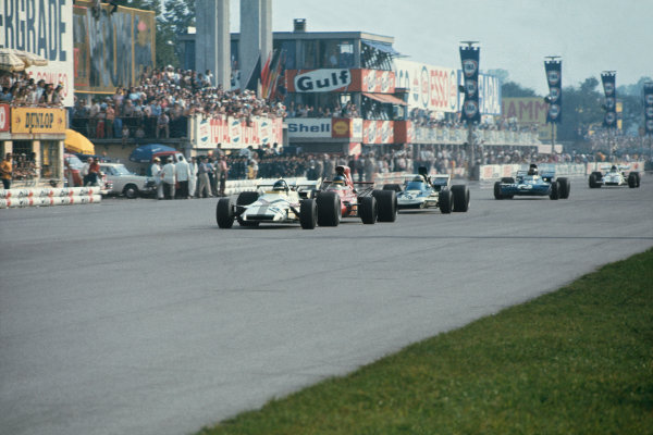 Monza, Italy.3-5 September 1971.Peter Gethin (BRM P160) wins from Ronnie Peterson (March 711 Ford), Mike Hailwood (Surtees TS9 Ford)Francois Cevert (Tyrrell 002 Ford) and Howden Ganley (BRM P160) in the closest finish and fastest race in GP history, action. World Copyright: LAT Photographic.Ref:  71ITA63.
