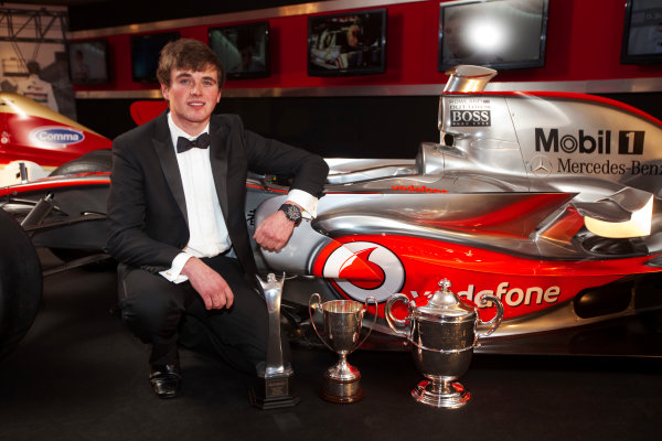 Grosvenor House Hotel, Park Lane, London 4th December 2011 McLaren Autosport BRDC Young Driver of the Year Award winner Oliver Rowland poses with the McLaren Mercedes F1 display car.World Copyright: Glenn Dunbar/LAT Photographic ref: Digtal Image GD5D0423