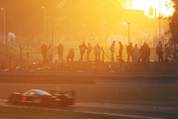 Le Mans, France. 13th - 17th June. Race. Fans watch as a Peugeot goes by at sunrise. Atmosphere. World Copyright: Kevin Wood/LAT Photographic. ref: Digital Image IMG_3743a