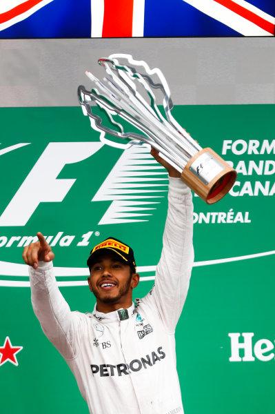 Circuit Gilles Villeneuve, Montreal, Canada. Sunday 12 June 2016. Lewis Hamilton, Mercedes AMG, 1st Position, lifts his trophy on the podium. World Copyright: Glenn Dunbar/LAT Photographic ref: Digital Image _V2I5832