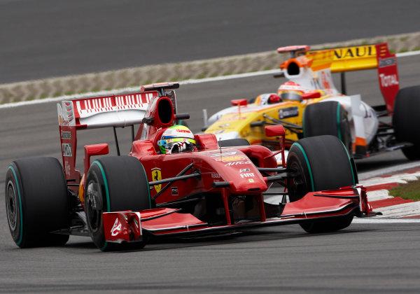 Nurburgring, Germany 10th July 2009 Felipe Massa, Ferrari F60, leads Fernando Alonso, Renault R29. Action.  World Copyright: Steve Etherington/LAT Photographic ref: Digital Image SNE14991
