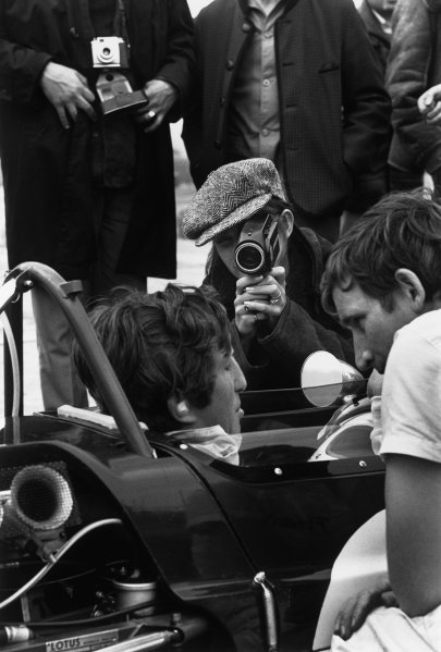 Charade, Clermont-Ferrand, France. 4-6 July 1969.Jochen Rindt (Lotus 49B-Ford Cosworth), 1st position, Wife Nina films her husband in the pits, portrait.World Copyright: LAT PhotographicRef: 2579 - 19A/20.