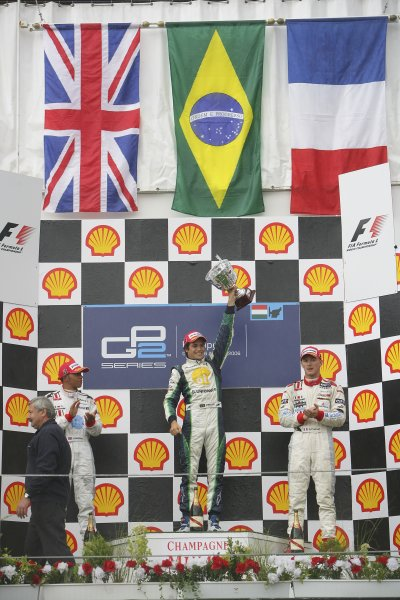 2006 GP2 Series Round 9. Hungaroring, Budapest, Hungary. 6th August 2006. Sunday race.Nelson Piquet Jr. (BRA, Piquet Sports) 1st, Lewis Hamilton (GBR, ART Grand Prix) 2nd, Alexandre Premat (FRA, ART Grand Prix) 3rd. Podium.World Copyright: Andrew Ferraro/GP2 Series Media Service. Ref: Digital Image Only.ZP9O0545 jpg