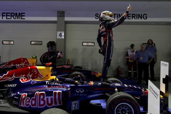 Marina Bay Circuit, Singapore.25th September 2011.Sebastian Vettel, Red Bull Racing RB7 Renault, 1st position, celebrates on arrival in Parc Ferme. Portrait. Helmets. Finish. World Copyright:Glenn Dunbar/LAT Photographicref: Digital Image IMG_1698