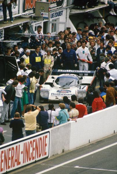 Le Mans, France. 11th - 12th June 1987.Hans-Joachim Stuck/Al Holbert/Derek Bell (Rothmans Porsche 962C), 1st position, pit stop action. World Copyright: LAT PhotographicRef: 87LM