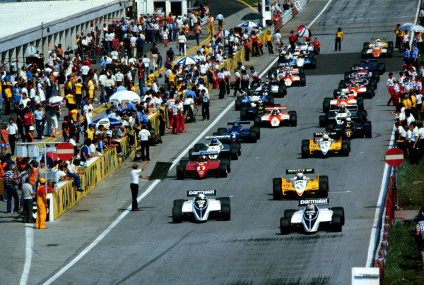 1982 Austrian Grand Prix.Osterreichring, Zeltweg, Austria.13-15 August 1982.Nelson Piquet and Riccardo Patrese (both Brabham BT50 BMW) lead at the start.World Copyright - LAT Photographic