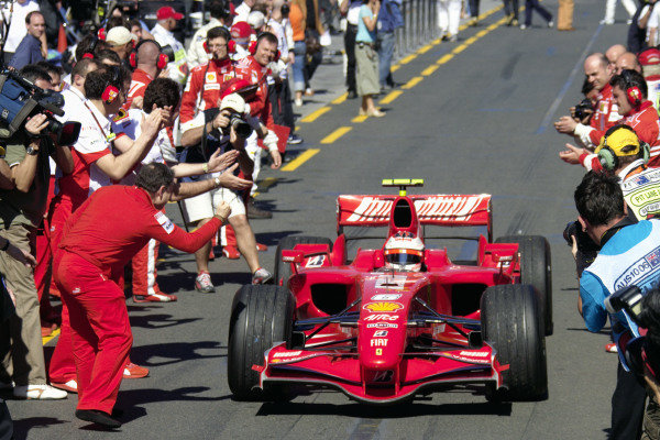 Jean Todt congratulates winner Kimi Räikkönen as he heads to parc fermé.
