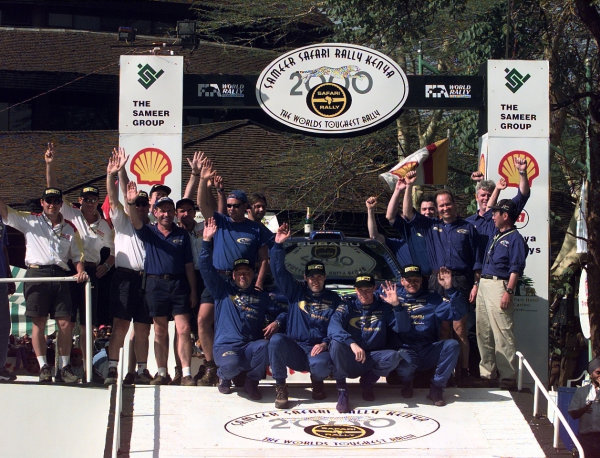 2000 World Rally Championship Round 3, Safari WRC 25th - 27th Feb 2000 Richard Burns, Subaru Impreza , rally winner with teammate Juhan Kankkunen, second place. Team Podium. Photo: McKlein/LAT
