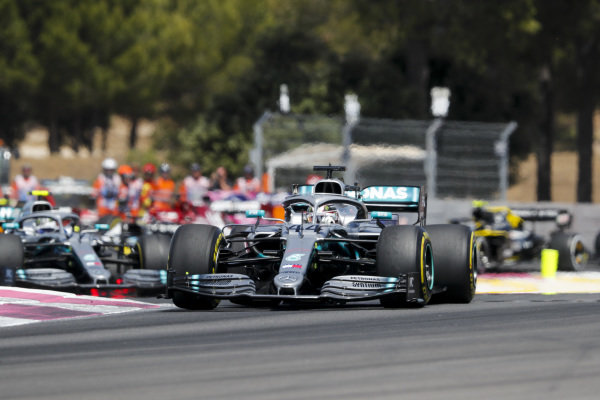 Lewis Hamilton, Mercedes AMG F1 W10 leads Valtteri Bottas, Mercedes AMG W10 at the start of the race
