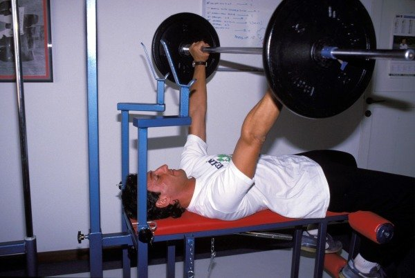 Padova, italy. Riccardo Patrese works out in his private gym
