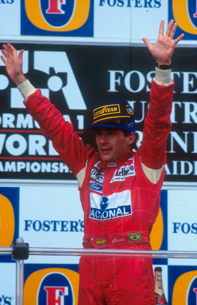 1993 Australian Grand Prix.Adelaide, Australia.5-7 November 1993.Ayrton Senna (McLaren Ford) celebrates 1st position on the podium, his last Grand Prix win .Ref-93 AUS 26.World Copyright - LAT Photographic