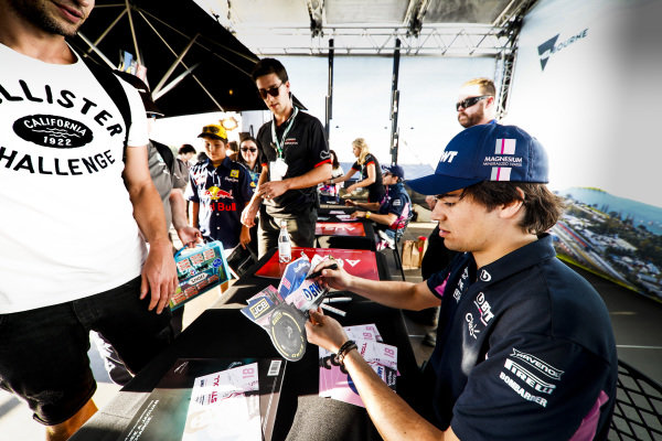 Lance Stroll, Racing Point signs an autograph for a fan