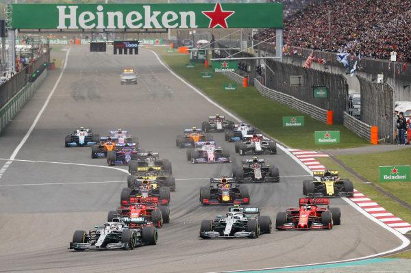 Lewis Hamilton, Mercedes AMG F1 W10 leads Valtteri Bottas, Mercedes AMG W10, Sebastian Vettel, Ferrari SF90 and Charles Leclerc, Ferrari SF90 at the start of the race