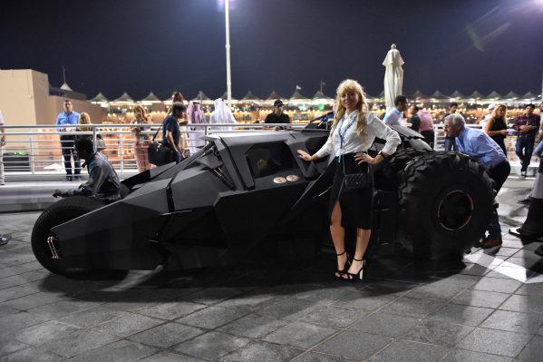 Girl and batmobile at Formula One World Championship, Rd19, Abu Dhabi Grand Prix, Practice, Yas Marina Circuit, Abu Dhabi, UAE, Friday 27 November 2015.