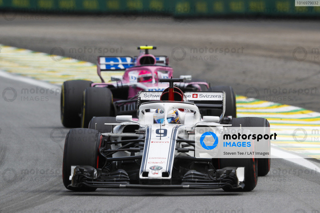 Marcus Ericsson, Alfa Romeo Sauber C37, leads Esteban Ocon, Racing Point Force India VJM11