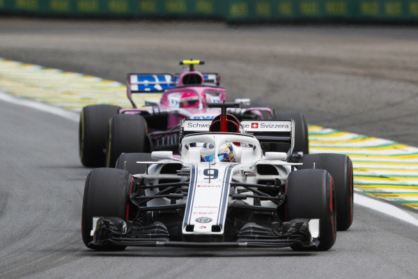 Marcus Ericsson, Alfa Romeo Sauber C37, leads Esteban Ocon, Racing Point Force India VJM11